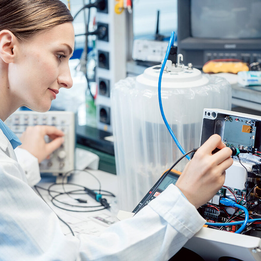 Engineer Woman Testing Electronics